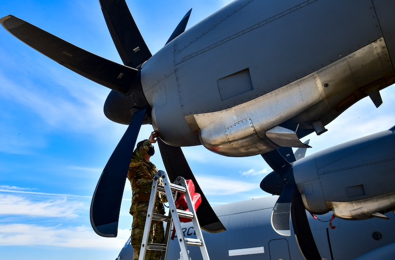 An Airman assigned to the 19th Airlift Wing conducts a post-flight check of a C-130J Super Hercules