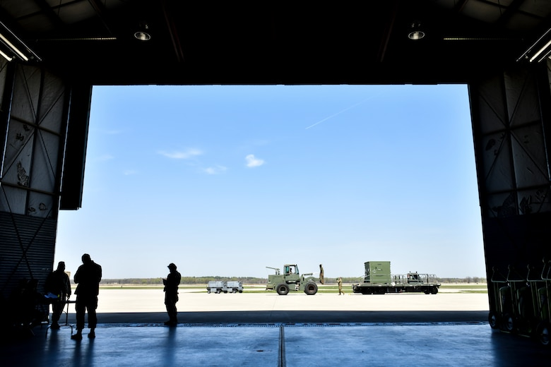 Airmen assigned to the 19th Logistics Readiness Squadron transport cargo