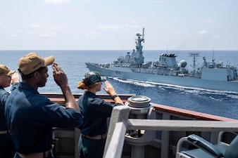 USS Laboon (DDG 58) renders honors to the Pakistan navy frigate PNS Saif (F 253) in the Arabian Sea.