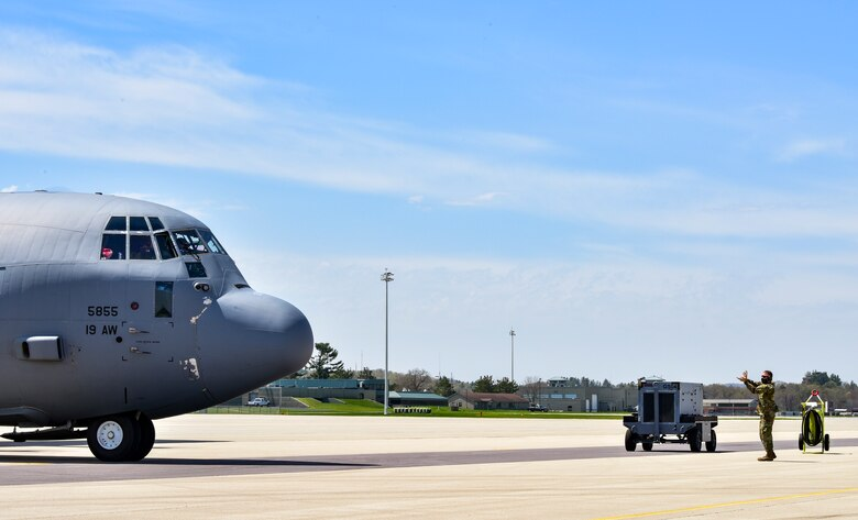 A C-130J Super Hercules assigned to the 19th Airlift Wing taxis into its parking spot