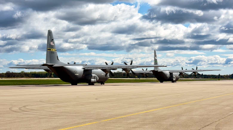 Two C-130J Super Hercules assigned to the 19th Airlift Wing taxi on the flightline at Volk Field Air National Guard Base
