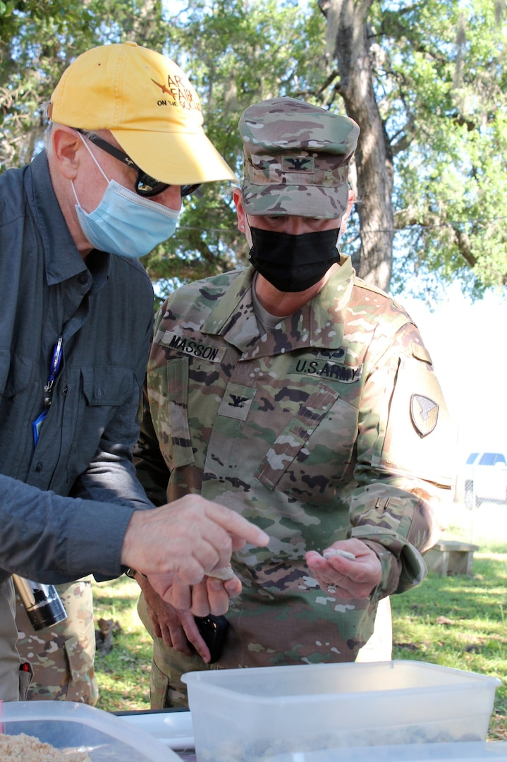 Scott Weber, a geologist, explains geometric patterns and stratification to Col. Alicia M. Masson