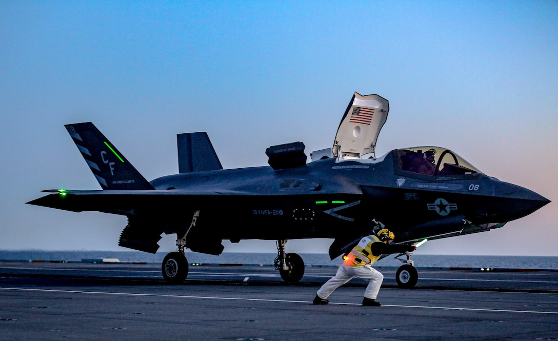 A U.S. Marine launches an F-35B Lightning II aboard HMS Queen Elizabeth at sea, May 6.