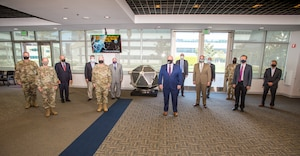 Representatives from the Space and Missile Systems Center and Northrop Grumman gathered on for the unveiling of a full-scale Vela satellite model presented by Northrop Grumman for permanent display at Los Angeles Air Force Base, California, May 4, 2021. Originated in 1960, Vela was the first space-based system used for nuclear surveillance. Today, the mission of monitoring nuclear detonations continues with payloads hosted on GPS satellites. (U.S. Space Force photo by Van Ha)