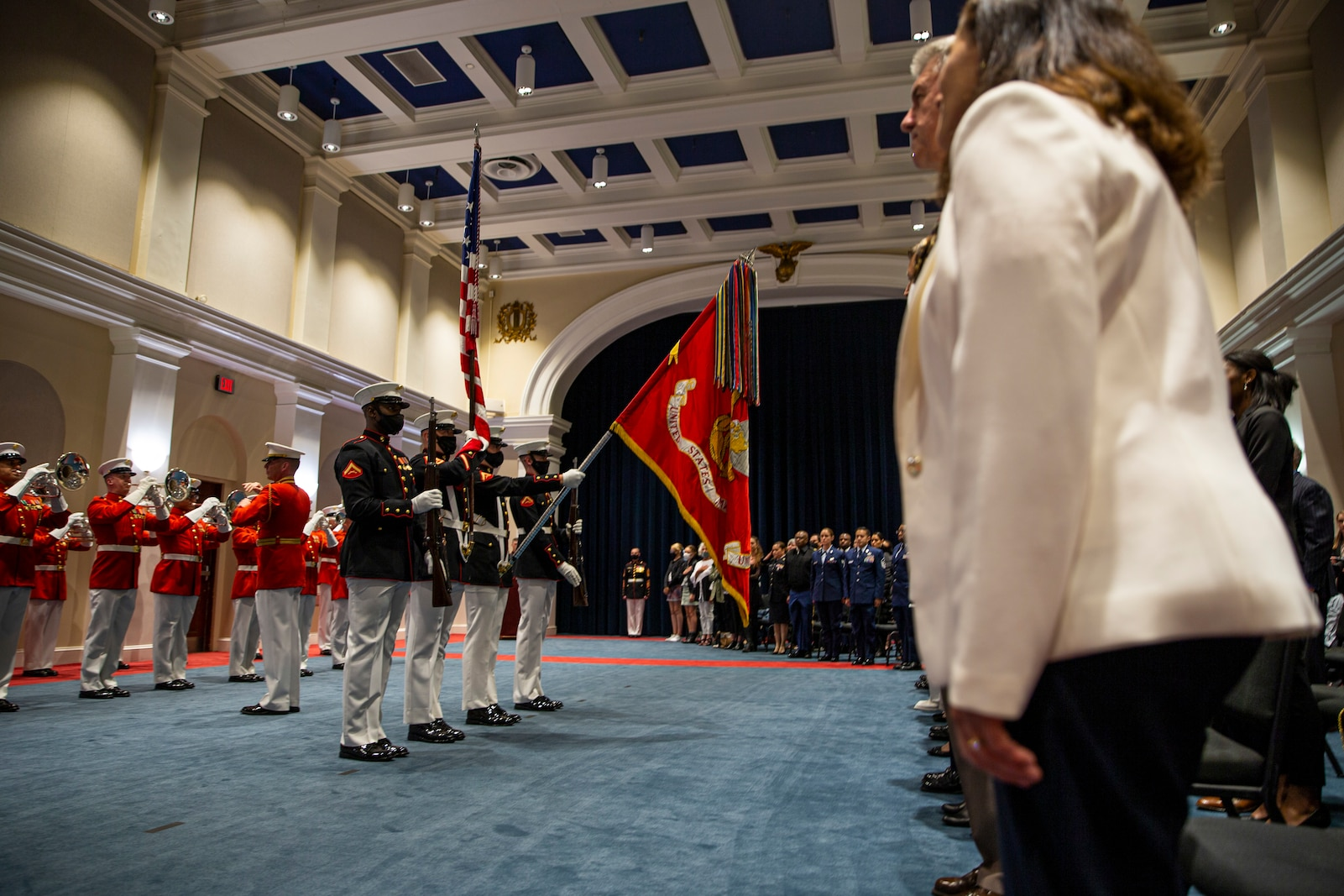 Marines with the Official Marine Corps Color Guard present the National Ensign during the Friday Evening Parade at Marine Barracks Washington, D.C., May 7, 2021.