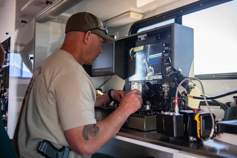 Tom McCue, Sacramento Sheriff's Office Explosive Ordnance Disposal (EOD) detective, operates a robot.