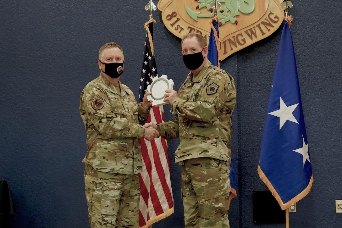 Winner receiving award from Lt. Gen. Webb