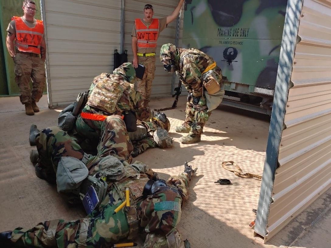 Airmen assisting injured person