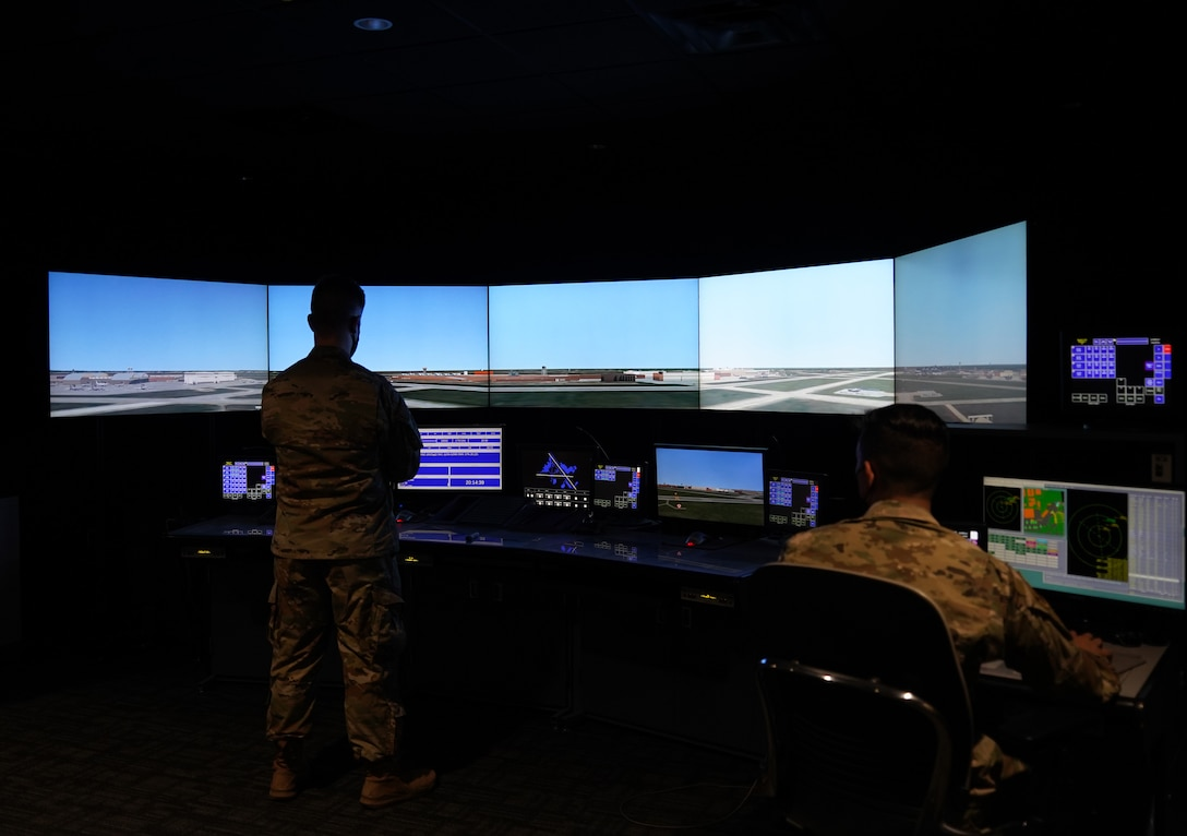 Two airmen in a simulated environment