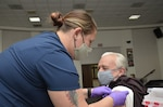 Nurse gives a vaccine shot