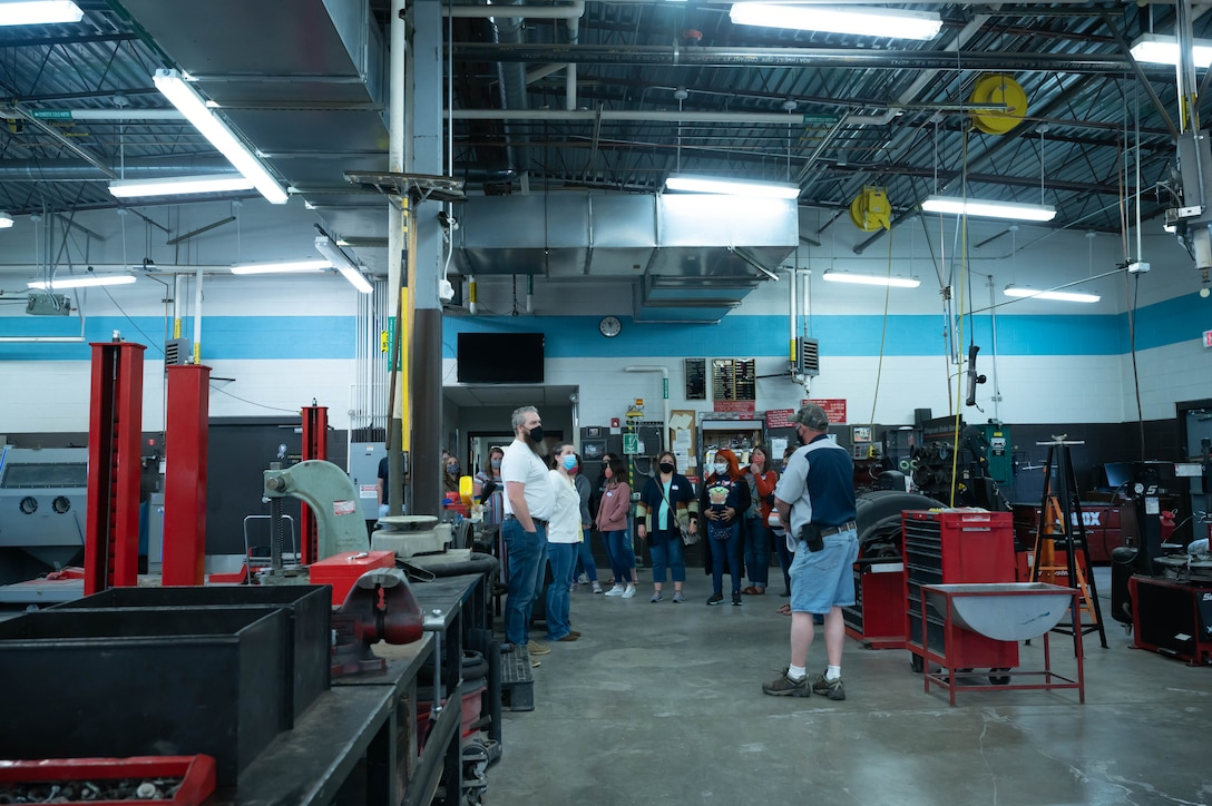 Military spouses visit the auto hobby shop during a Military Spouse Appreciation Day tour May 7, 2021, at Malmstrom Air Force Base, Mont.