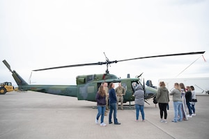 "Members of the 40th Helicopter Squadron explain their mission to military spouses and show off a UH-1N ""Huey"" helicopter during a tour May 7, 2021, at Malmstrom Air Force Base, Mont."