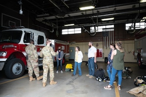 Airmen from the 341st Civil Engineer Squadron fire department give a tour of the fire house to military spouses May 7, 2021, at Malmstrom Air Force Base, Mont.