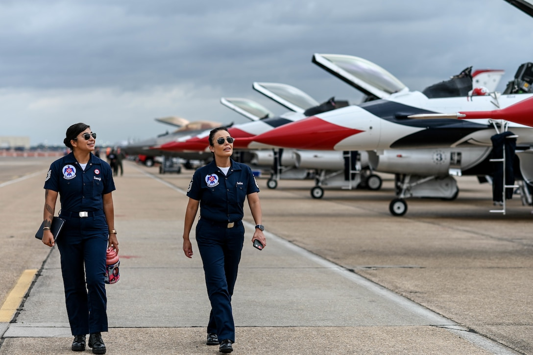 """Airmen assigned to the U.S. Air Force Air Demonstration Squadron, """"Thunderbirds,"""" approach their aircraft at the 2021 Defenders of Liberty Air & Space Show at Barksdale Air Force Base, Louisiana, May 9, 2021. As the U.S. Air Force's premier aerial demonstration team, the Thunderbirds showcase the pride and precision of today's Air Force. (U.S. Air Force photo by Senior Airman Christina Graves)"""