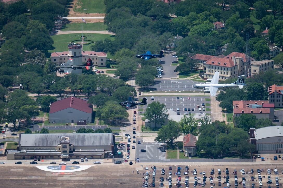 Historic World War II bombers fly over the flightline during the Barksdale Defenders of Liberty Air & Space show at Barksdale Air Force Base, Louisiana, 2021. The Defenders of Liberty airshow was first held in 1933 and is a full weekend of military and civilian aircraft, with performances and displays. (U.S. Air Force photo by Airman 1st Class Chase Sullivan)