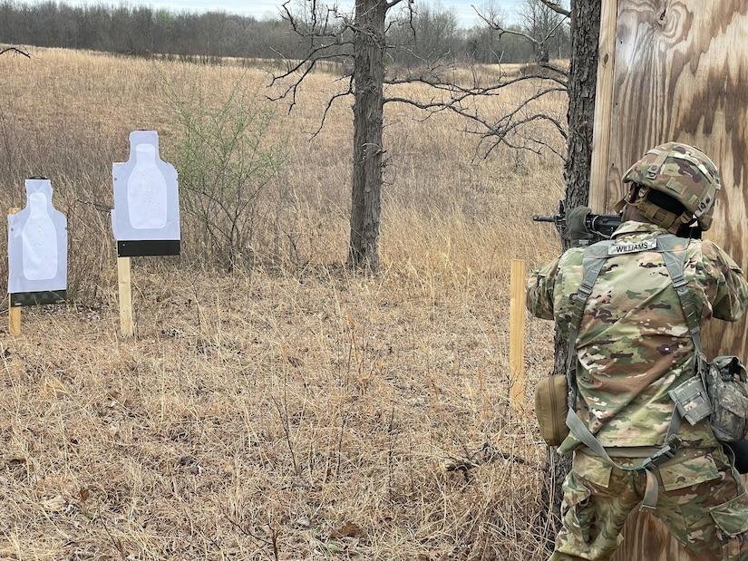 soldier fires M1 behind tree