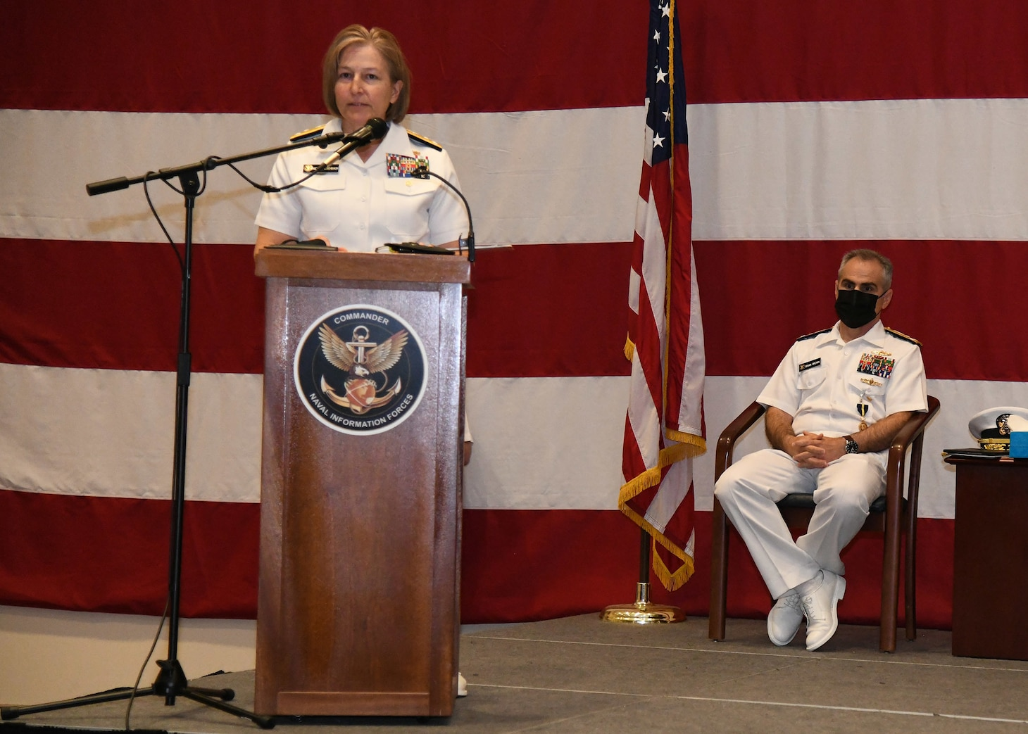 Vice Adm. Kelly Aeschbach speaks during a change of command ceremony.
