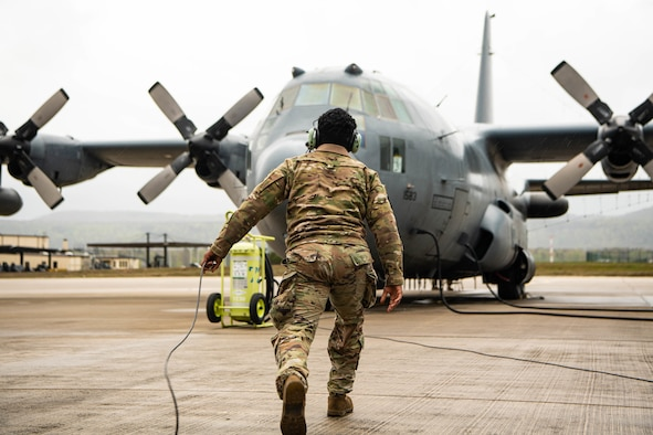 Male Airman prepares aircraft for take-off