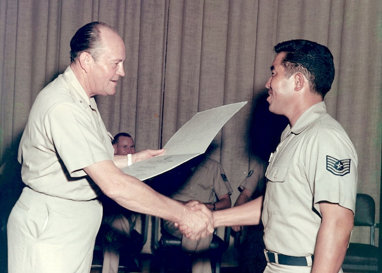 Air Force Brig. Gen. I.G. Brown presents the NCO academy diploma to Tech. Sgt. G.M. Matsuguma, Class 69-D, from Hawaii during the graduation ceremony on McGhee Tyson Air National Guard Base in East Tennessee. General Brown established the Air Guard's NCO academy and retired in 1974 after achieving the rank of Major General and serving as the 1st Director of the Air Guard.  (U.S. Air National Guard file photo)