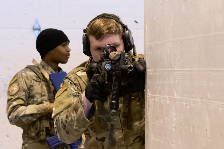 Senior Airman Taylor Tate, right, 341st Missile Security Forces Squadron tactical response force team member and Airman First Class Joshua Haynes, 341st Security Forces Squadron defender, move through the shoot-house during an active shooter training scenario April 27, 2021 at Malmstrom Air Force Base, Mont.