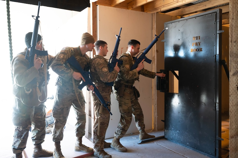 Members of the 341st Security Forces Squadron participate in breach training April 27, 2021 at the shoot-house at Malmstrom Air Force Base, Mont.