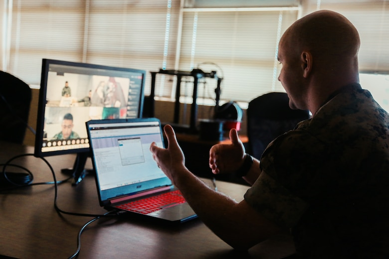 A U.S. Marine demonstrates Defensive Cyberspace Operations-Internal Defensive Measures capabilities during a virtual training session with members of the Philippine Marine Corps on Camp Hansen, Okinawa, Japan, April 19.