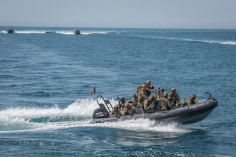 Special warfare operators from Georgia, Romania, Spain and the United States conduct visit, board, search and seizure training during Trojan Footprint 21 off the coast of Romania.