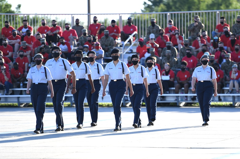 Members of the 335th Training Squadron regulation drill team performs during the 81st Training Group drill down on the Levitow Training Support Facility drill pad at Keesler Air Force Base, Mississippi, May 6, 2021. Airmen from the 81st TRG competed in a quarterly open ranks inspection, regulation drill routine and freestyle drill routine. While in training, Airmen are given the opportunity to volunteer to learn and execute drill down routines. (U.S. Air Force photo by Kemberly Groue)