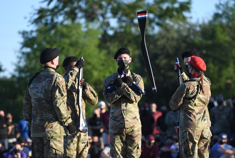 Members of the 336th Training Squadron freestyle drill team performs during the 81st Training Group drill down on the Levitow Training Support Facility drill pad at Keesler Air Force Base, Mississippi, May 6, 2021. Airmen from the 81st TRG competed in a quarterly open ranks inspection, regulation drill routine and freestyle drill routine. While in training, Airmen are given the opportunity to volunteer to learn and execute drill down routines. (U.S. Air Force photo by Kemberly Groue)