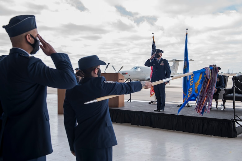 Members of the 310th Special Operations Squadron give Air Force Lt. Col. Joshua Stinson (right), 310 SOS commander, his first salute at the 310 SOS activation ceremony at Cannon Air Force Base, N.M., May 4, 2021. The 310 SOS was activated recently to align with the Air Force Special Operations Command's new deployment plans, providing a more sustainable and predictable deployment cycle to allow Air Commandos more time at home station to develop themselves and the culture of the squadron. (U.S. Air Force photo by Senior Airman Vernon R. Walter III)