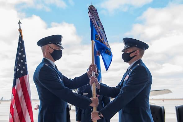 Air Force Col. Michael Shreves (left), 27th Special Operations Group commander, passes the guidon to Air Force Lt. Col. Joshua Stinson (right), 310th Special Operations Squadron commander, at the 310 SOS activation ceremony at Cannon Air Force Base, N.M., May 4, 2021. The 310 SOS was activated recently to align with the Air Force Special Operations Command's new deployment plans, providing a more sustainable and predictable deployment cycle to allow Air Commandos more time at home station to develop themselves and the culture of the squadron. (U.S. Air Force photo by Senior Airman Vernon R. Walter III)