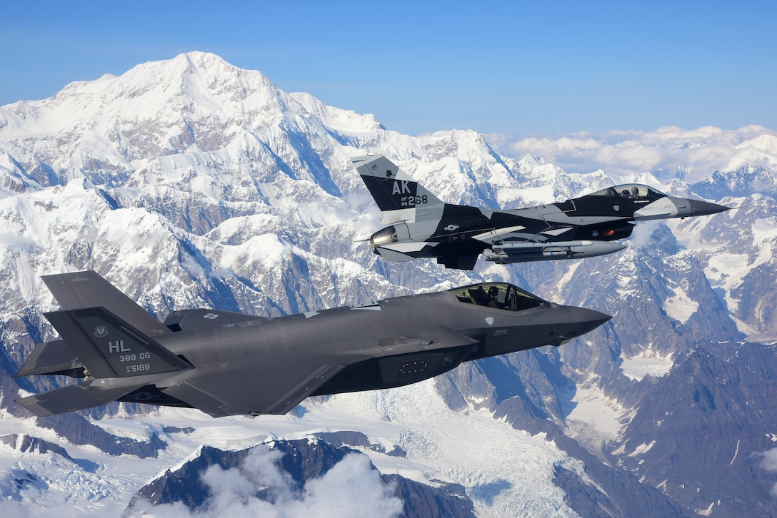 An F-35A Lightning II, assigned to the 388th Fighter Wing at Hill Air Force Base in Utah, and an F-16 Fighting Falcon, assigned to the 18th Aggressor Squadron at Eielson Air Force Base in Alaska, fly over Denali National Park, Alaska, Aug. 17, 2020. The 388th FW's F-35As made their debut in RED FLAG-Alaska 20-3 training alongside F-35As from the 356th Fighter Squadron at Eielson Air Force Base, Alaska. (U.S. Air Force photo by Tech. Sgt. Jerilyn Quintanilla)