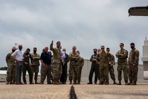 U.S. Air Force Gen. Mark Kelly, commander of Air Combat Command, middle, and more than 20 distinguished visitors observe multi-capable Airmen conduct an integrated combat turn (ICT) at Eglin Air Force Base, Florida, May 4, 2021.