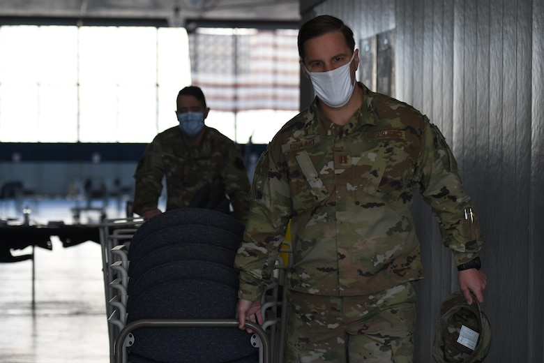 U.S. Air Force Captain Steven Goulart, 42nd Medical Group Logistics Flight Commander, transports supplies from the COVID Vaccination Site at Maxwell Air Force Base, Alabama, May 7, 2021. The current COVID-19 vaccination site is relocating from Maxwell's Honor Guard Hanger to the Immunizations Clinic.