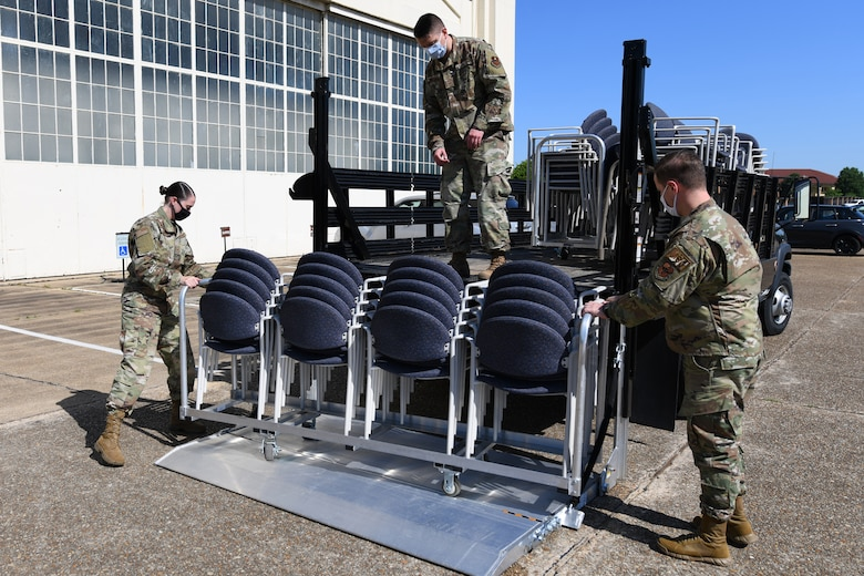 U.S. Air Force Airman assigned to the 42nd Medical Group load seating and supplies onto a flatbed at Maxwell Air Force Base, Alabama, May 7, 2021. The current CVOID-19 vaccination site is moving from Maxwell's Honor Guard hanger to the Immunizations Clinic.