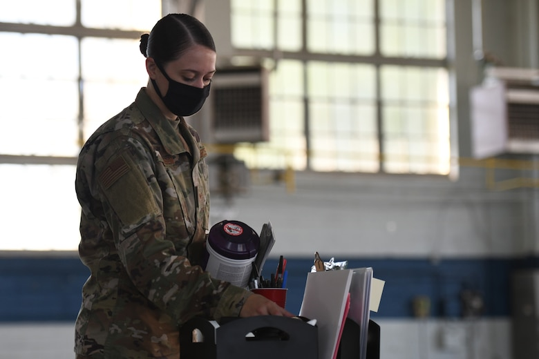 U.S. Air Force Staff Sergeant Amber Hansen, 42nd Medical Group Medical Materialist, collects medical supplies for relocation at Maxwell Air Force Base, Alabama, May 7, 2021. The current COVID-19 vaccination site is moving from Maxwell's Honor Guard hanger to the Immunizations Clinic.