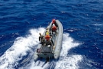 PACIFIC OCEAN (April 26, 2021) Members of the U.S. Coast Guard  Law Enforcement Detachment 104 and Sailors assigned to Independence-variant littoral combat ship USS Charleston (LCS 18) ride in a rigid-hull inflatable boat, April 26. Charleston is part of the Oceania Maritime Security Initiative (OMSI), a Secretary of Defense program leveraging Department of Defense assets transiting the region to increase the Coast Guard's maritime domain awareness, ultimately supporting its maritime law enforcement operation in Oceania. (U.S. Navy photo by Mass Communication Specialist 3rd Class Adam Butler)