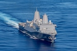 In this file photo, San Antonio Class amphibious transport dock ship USS New Orleans (LPD 18) transits the Philippine Sea. The America Amphibious Ready Group, assigned to Amphibious Squadron Eleven, along with the 31st Marine Expeditionary Unit, is operating in the U.S. 7th Fleet area of responsibility to enhance interoperability with allies and partners and serve as a ready response force to defend peace and stability in the Indo-Pacific region.