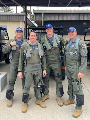 (Left to Right) Majors Robert Carpenter, Daniel Levy, James Buchanan, and Ryan Cummings, 47th Fighter Squadron pilots, pose for a photo before stepping to their A-10 Thunderbolt IIs during the Hawgsmoke 2021 competition at Moody Air Force Base, Ga., April 13-17, 2021. The competition consisted of A-10 Thunderbolt II four-ship teams from around the world fighting to be considered the 'Best of the Best' in ground attack and target destruction. These pilots brought home 2nd place overall. The 47th FS, a flying squadron in the 924th Fighter Group at Davis-Monthan Air Force Base, Arizona, is a Geographically Separated Unit of the 944th Fighter Wing.
