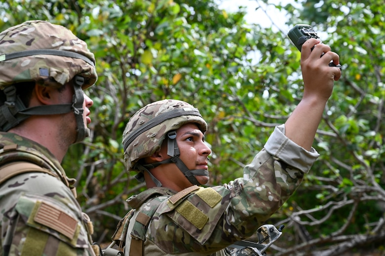 U.S. Air Force Airman 1st Class Adam Lixey and Airman 1st Class Brayan Rivera systems technicians assigned to the 644th Combat Communications Squadron, practice their land navigation skills during exercise Dragon Forge on North West Field, Guam, April 13, 2021. Exercise Dragon Forge is a combat skills training course that prepares participants to deploy to austere locations. (U.S. Air Force photo by Tech. Sgt. Esteban Esquivel)