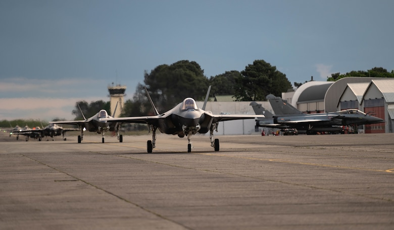 U.S. Air Force F-35A Lightning IIs assigned to the 4th Fighter Squadron, Hill Air Force Base, Utah, taxi down the flightline at Mont-de-Marsan Air Base, France, May 10, 2021. During their time in the European theater, the 4th FS aircraft will participate in multiple events, including Atlantic Trident 21, underscoring the steadfast U.S. commitment to the region and enhancing interoperability with NATO allies and partners. (U.S. Air Force photo by Staff Sgt. Alexander Cook)
