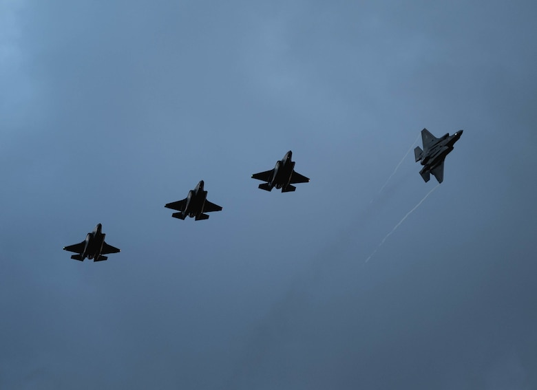 Four U.S. Air Force F-35A Lightning IIs assigned to the 4th Fighter Squadron, Hill Air Force Base, Utah, fly over Mont-de-Marsan Air Base, France, upon arrival May 10, 2021. During their time in the European theater, the 4th FS aircraft will participate in multiple events, including Atlantic Trident 21, underscoring the steadfast U.S. commitment to the region and enhancing interoperability with NATO allies and partners. (U.S. Air Force photo by Staff Sgt. Alexander Cook)