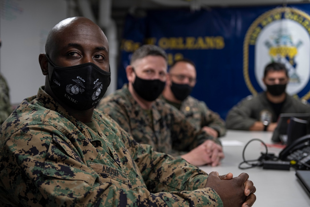SASEBO, Japan (April 26, 2021) U.S. Navy and Marine Corps officers partake in a video teleconference onboard amphibious transport dock ship USS New Orleans (LPD 18) as part of Fleet Synthetic Training-Joint. New Orleans, part of the America Amphibious Ready Group, along with the 31st Marine Expeditionary Unit, is operating in the U.S. 7th Fleet area of responsibility to enhance interoperability with allies and partners and serve as a ready response force to defend peace and stability in the Indo-Pacific region. (U.S. Navy photo by Mass Communication Specialist 2nd Class Kelby Sanders)