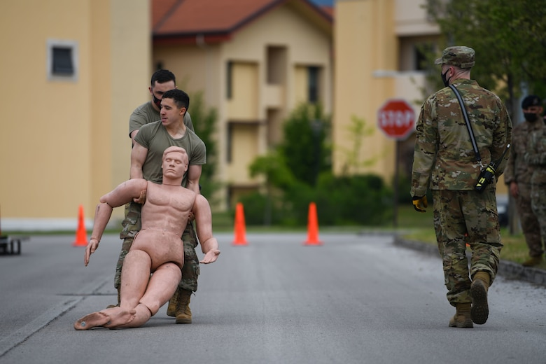Airman Wesley J. Harding-Brown, 31st Security Forces Squadron (SFS) member, participate in a body drag for Police Week at Aviano Air Base, Italy, May 11, 2021. Airmen from the 31st SFS and 31st Civil Engineer Squadron competed in an obstacle course. The course consisted of a hose drag, litter carry, body drag, tire flips, Keiser FORCE Machine, sprints, M4 carbine assembly and disassembly, and a Humvee team push. (U.S. Air Force photo by Senior Airman Ericka A. Woolever)
