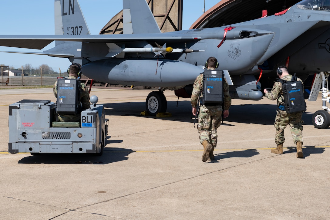 Weapons load crew members with the 492nd Aircraft Maintenance Unit prepare to work on an F-15E Strike Eagle with the new Theater Readiness Tactical Line Equipment packs at Royal Air Force Lakenheath, England, April 22, 2021. Designed to hold the minimal tools and equipment necessary to work on aircraft in a deployed environment, the lightweight backpack-style carriers weigh roughly 20 pounds, allowing Airman to carry and transport them to austere locations much easier than a full toolkit. (U.S. Air Force photo by Airman 1st Class Cedrique Oldaker)