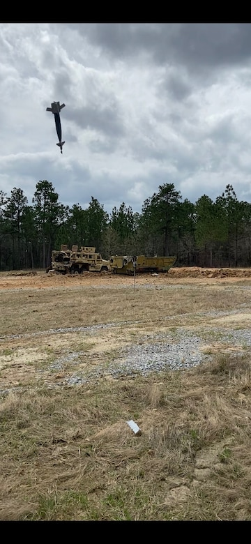 An inert Joint Direct Attack Munition (JDAM) bomb drops at the Camp Shelby Air-to-Ground Range, also known as the Rattlesnake Range in Perry County, Miss., March 2021.