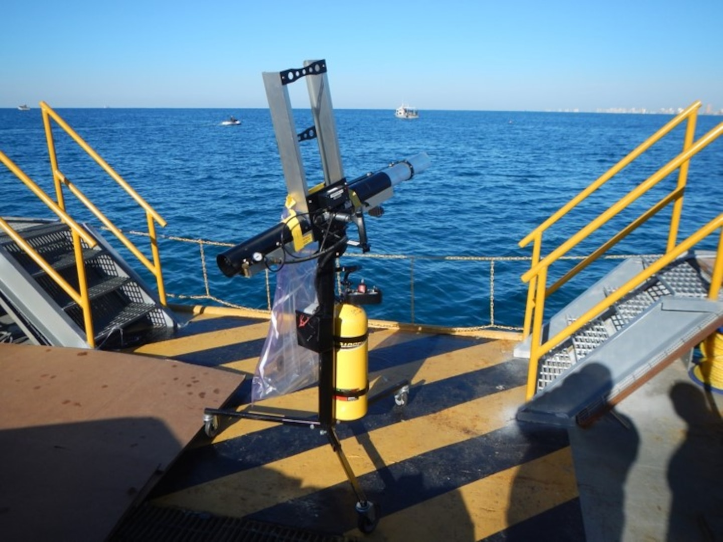 A standard, off-the-shelf, t-shirt cannon is used to shoot out the device for non-lethal stoppage of water jet propelled craft.