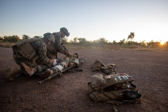 Navy corpsmen provide care to Marines during a simulated medical evacuation in Australia.