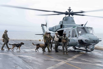 Marines board a U.S. Marine Corps UH-1Y Venom helicopter aboard USS Somerset (LPD 25) during Northern Edge 2021.