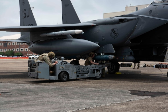 Photo of F-15 getting bomb loaded